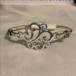 Silver tone bangle bracelet.